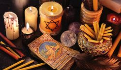 cropped-stock-photo-magic-objects-candles-and-the-tarot-cards-in-candle-light-fortune-telling-seance-or-black-magic-391017364.jpg